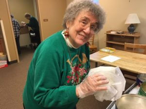 Sister Rosella packs Christmas cookies for inmates of the Beaver County Jail.