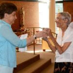 Sister Christine Kresho, left, offers communion at Our Lady of Grace Church in Silver Spring, Md.