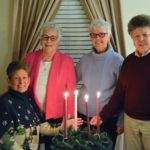 Sisters Pat Montini, Anna Marie Gaglia, Anne Green and Sue Clay gathered around Advent candles