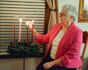 Sister Anna Marie Gaglia lights third Advent candle