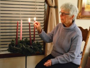 Sister Anne Green lights second Advent candle