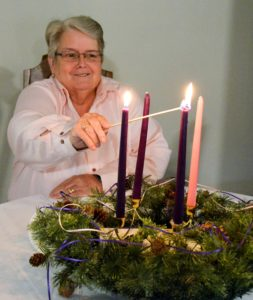 Sister Betty Adams lights candle for second week of Advent