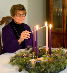 Sister Dolores Montini lights candle for third week of Advent