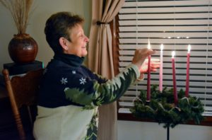 Sister Pat Montini lights fourth Advent candle