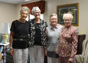 Sister Elizabeth Brush, second from left, with residents of St. Augustine Plaza.