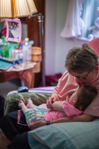 Sister Sandy Kiefer holds a medically fragile foster child who is in her care.