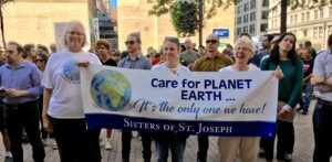 Sisters of St. Joseph holding a banner that reads Care for the Planet Earth, it's the only one we have. They were attending a climate march in Pittsburgh.