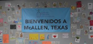 "Welcome sign that says ""Bienvenidos"" at at the Humanitarian Respite Center in McAllen, Texas"