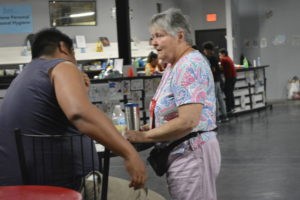Sister Janice Vanderneck welcomes a Venezuelan man to the Humanitarian Respite Center in McAllen, Texas