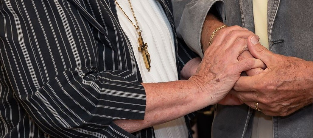 "Hands of a Sister of St. Joseph clasping hands of a ""dear neighbor"""