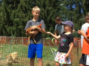 Students visit the chickens on the Sisters of St. Joseph grounds